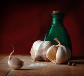 Vintage still life with garlic, salt and allspice — Stock Photo