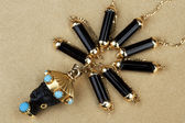 Ornament from gold and black onyx — Stock Photo