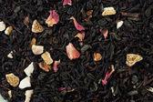 Black tea a background — Stock Photo