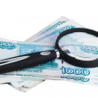 Russian money roubles and magnifying glass — Stock Photo