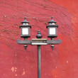 Foto Stock: Old style lamp with red wall