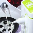 Electric car in charging - 图库照片