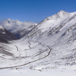 Snow mountain with winding road in tibet — Stock Photo