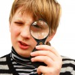 A boy and a magnifying glass — Stock Photo #2779206