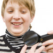 A boy and a magnifying glass — Stock Photo