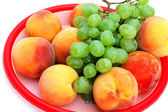 Grapes and peaches — Stockfoto
