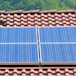Stock Photo: House with solar panels on roof