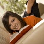 Reading on the sofa — Stock Photo