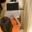 Young woman working at home with her laptop — Stock Photo #3162752