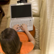 Young woman working at home with her laptop — Stock Photo