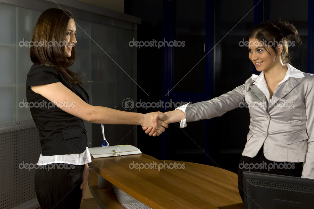 Two business women shaking hands  — Stock Photo #3162659