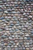 Vägg av många-färgade kullersten — Stockfoto