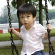 Boy on a swing — Stock Photo