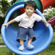 Boy standing on a slide — Stock Photo #2937264