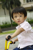 Boy on a tricycle — Stock Photo