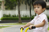 Boy on tricycle — Stock Photo