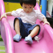 Boy on slide — Stock Photo