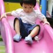 Boy on slide — Stock Photo
