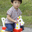 Boy on toy horse — Stock Photo