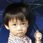 Boy with umbrella — Stock Photo