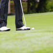Stock Photo: Golfer putting