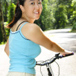 Woman with bicycle — Stock Photo #3161792