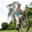 Woman cycling - Stock Photo
