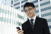 Business executive using phone — Stok fotoğraf