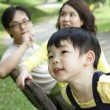 Child with family — Stock Photo #3348981