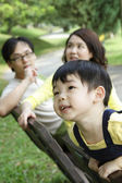 Child with family — Stock Photo