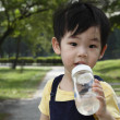 Cute Boy with bottle — Stock Photo