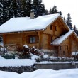 Chalet in Jura mountain by winter - Stock Photo