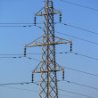 Electrical pylon by sunset — Stockfoto