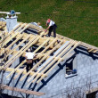 Stock Photo: Carpenter building a roof of a house
