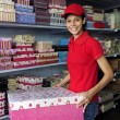 Young woman working in a gift box store — Stock Photo