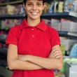 Teenage girl working part time in a stationery s — Stock Photo