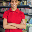 Teenage girl working part time in a stationery s — Stock Photo #2797418