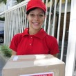 Delivery courier delivering package — Stock Photo