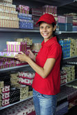Young womanl working in a store — Stock Photo