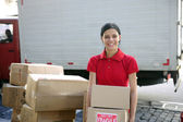 Delivery courier or mover delivering cardboards — Stock Photo