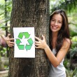 Recycling: woman in the forest holding a recycle — Stock Photo #3205111
