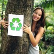 Recycling: woman in the forest holding a recycle — Stock Photo #3205183
