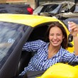 Stock Photo: Woman showing keys of her new sports car