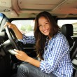 Woman driving her new bulletproof truck — Stockfoto