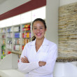 Portrait of a female pharmacist at pharmacy — Stock Photo