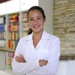 Portrait of a female pharmacist at pharmacy — Stock Photo
