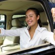 Stock Photo: Businesswoman showing keys of her new off-road v