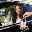 Businesswoman receiving keys of her new off-road — Stock Photo #3205633