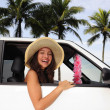 Car rental: happy woman in her car near the beac — Stock Photo