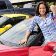 Woman showing key of new sports car — Stock Photo #3205705